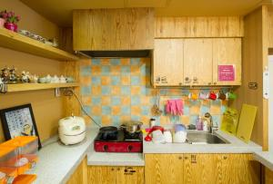 A kitchen or kitchenette at UWA Guesthouse