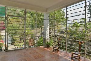 A balcony or terrace at Indrakeel Farmstay by Vista Rooms
