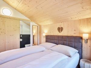 A bed or beds in a room at Bergeralm Chalets