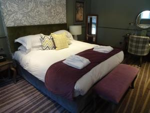 A bed or beds in a room at The Stanneylands