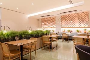 Ein Restaurant oder anderes Speiselokal in der Unterkunft Ars Magna Bleisure Hotel