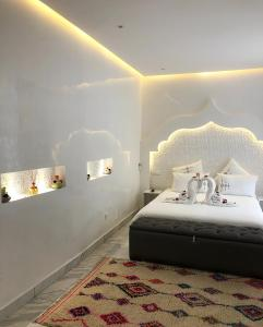 A bed or beds in a room at RIAD NOLITA & SPA Kasbah