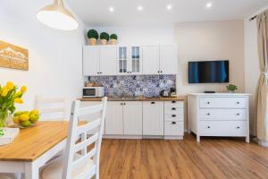Kuchyňa alebo kuchynka v ubytovaní Apartmán Hory - V srdci Tatier