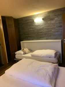 Ein Bett oder Betten in einem Zimmer der Unterkunft Hosquet Lodge
