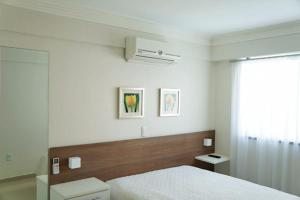 A bed or beds in a room at bombinha summer beach apartamento privado