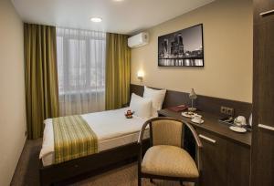 Кровать или кровати в номере Отель Хакасия