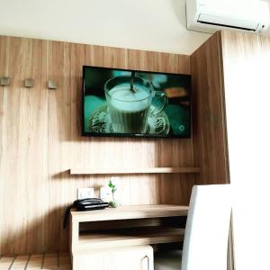 A television and/or entertainment center at Hotel Giardino