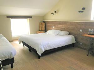 A bed or beds in a room at DOMAINE ST GERMER