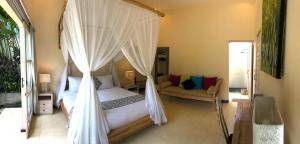 A bed or beds in a room at Villa Rumah Lumbung