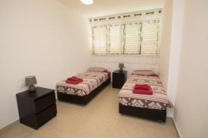 Postelja oz. postelje v sobi nastanitve Hadass Desert Inn