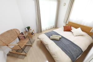 A bed or beds in a room at Ota-ku - House / Vacation STAY 6683