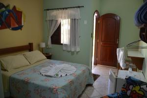 A bed or beds in a room at POUSADA NOSSA SENHORA
