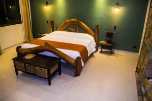 A bed or beds in a room at Byblos Resort & Casino