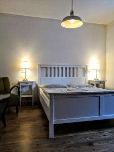 A bed or beds in a room at Apartmány Červený Dvůr
