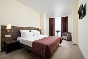 Кровать или кровати в номере Санаторно-курортный комплекс Русь