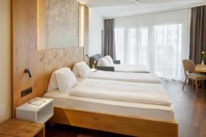 Ein Bett oder Betten in einem Zimmer der Unterkunft Hotel Rössli Gourmet & Spa