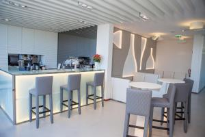 A restaurant or other place to eat at Tempus Hotel & Spa - Singular's Hotels