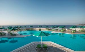The swimming pool at or close to Mitsis Family Village Beach Hotel
