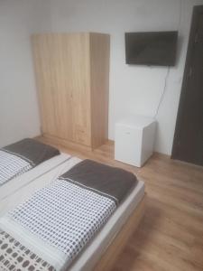 Кровать или кровати в номере Guest House Delphini