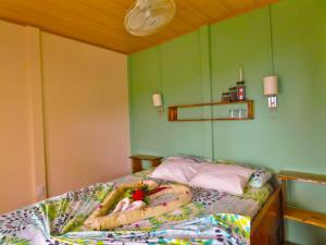 A bed or beds in a room at Hotel Casa Gitana Corcovado