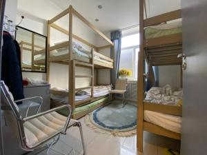 A bunk bed or bunk beds in a room at Hostel Rus - VDNH