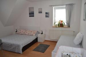 Postel nebo postele na pokoji v ubytování Pension u sovy