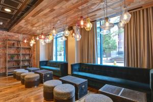 A seating area at Curio Collection by Hilton The Cincinnatian Hotel
