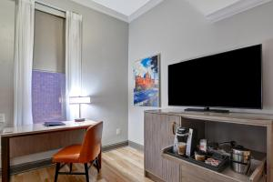 A television and/or entertainment center at Curio Collection by Hilton The Cincinnatian Hotel