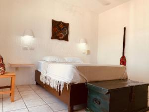 A bed or beds in a room at Caribo Cozumel