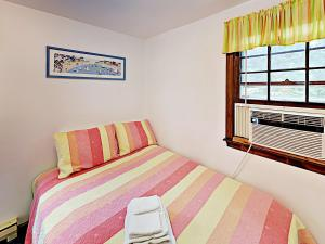 A bed or beds in a room at Dennisport Duplex by the Beach