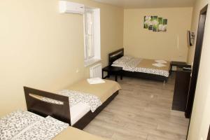 """Кровать или кровати в номере """"Солнечная орхидея"""""""