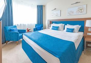 Кровать или кровати в номере Ramada By Wyndham Yekaterinburg Hotel & Spa