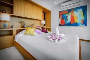A bed or beds in a room at Jamahkiri Resort & Spa
