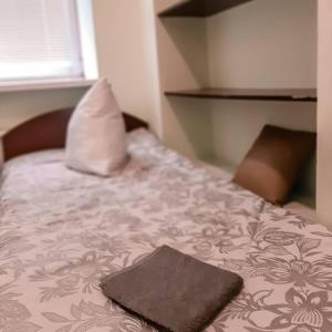 A bed or beds in a room at Capsularhouse Hostel