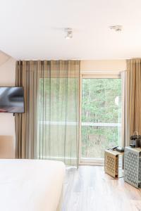 Een bed of bedden in een kamer bij Blooming