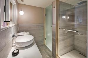 Ванная комната в Constance Belle Mare Plage