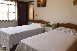 A bed or beds in a room at Hotel Casarao