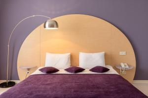 A bed or beds in a room at Design Hotel Skopeli