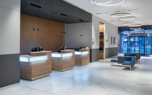 The lobby or reception area at Courtyard by Marriott Bucharest Floreasca
