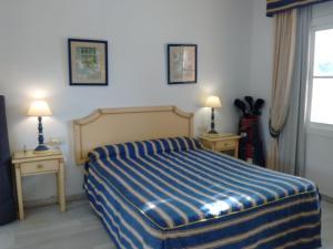 A bed or beds in a room at Resort Spa de lujo Mijas Costa
