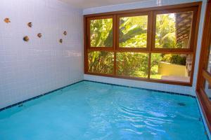 The swimming pool at or near Portobello Praia