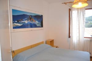 A bed or beds in a room at Hotel Scoglio Bianco