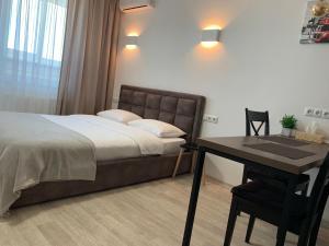 Кровать или кровати в номере Святобор LUX Apartments