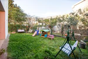 Children's play area at Apartments Kovačević