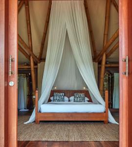 A bed or beds in a room at Bawah Reserve