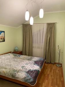 Кровать или кровати в номере Holiday Home N2 Ruza village