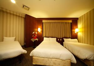 A bed or beds in a room at Hotel Hillarys