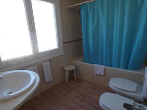A bathroom at Utopia Beach House