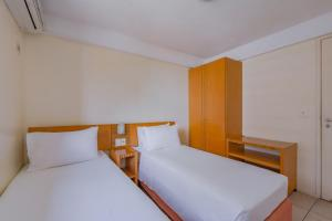 A bed or beds in a room at Hotel Mercure Fortaleza Meireles