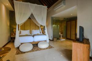 A seating area at Purana Suite Ubud
